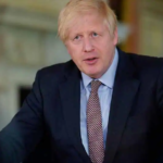 The British Prime Minister Boris Johnson claps for health workers fighting corona virus infection and says Thank You