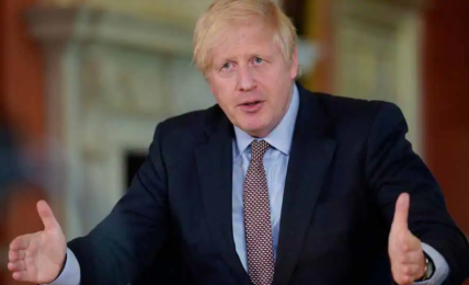 British Prime Minister Boris Johnson claps