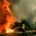 Wildfires burn through record area in California as blazes continue to spread